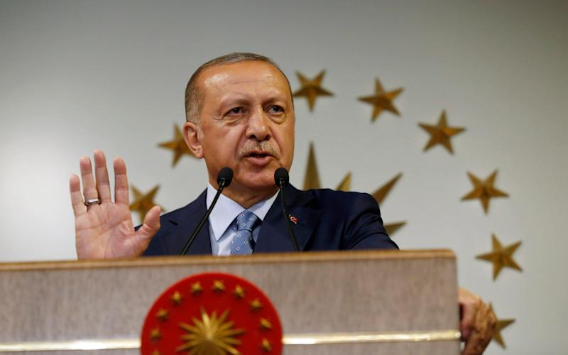 Turkey's President Recep Tayyip Erdogan has been speaking after a rapid devaluation in the country's currency - AP