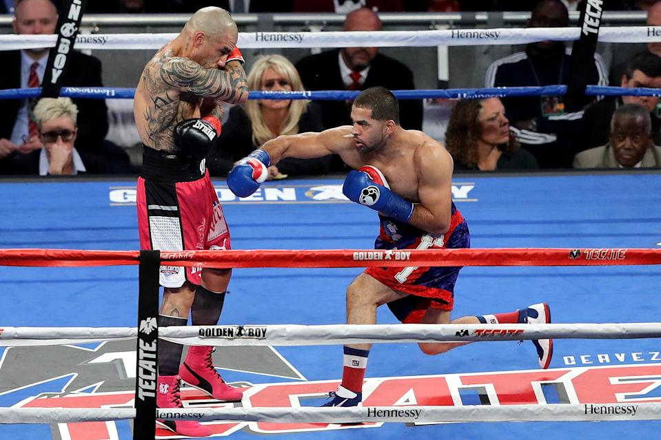 Sadam Ali (R) throws a right hand Saturday at Miguel Cotto in their WBO super welterweight title fight at Madison Square Garden. (Getty)