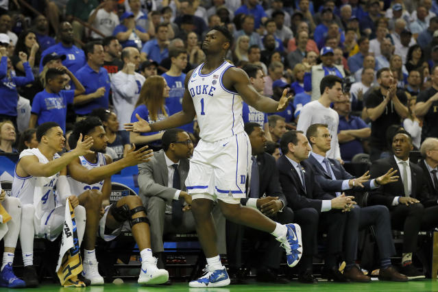 <p>Zion Williamson #1 of the Duke Blue Devils celebrates a basket against the UCF Knights during the first half in the second round game of the 2019 NCAA Men's Basketball Tournament at Colonial Life Arena on March 24, 2019 in Columbia, South Carolina. (Photo by Kevin C. Cox/Getty Images) </p>