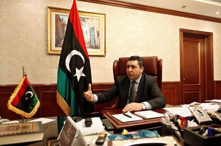 Khalifa Ghwell, a self-declared prime minister, gestures during an interview with Reuters, in Tripoli