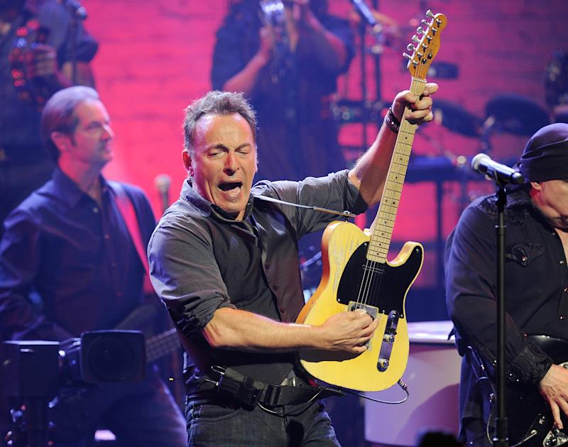 FILE - This March 9, 2012 file photo shows Bruce Springsteen and the E Street Band performing at the Apollo Theater in New York. Bruce Springsteen is returning to headline the London Hard Rock Calling festival, a year after authorities pulled the plug on his duet with Paul McCartney for violating a curfew. Springsteen will headline the second night of the two-day festival on June 30, 2013. (AP Photo/Evan Agostini, File)