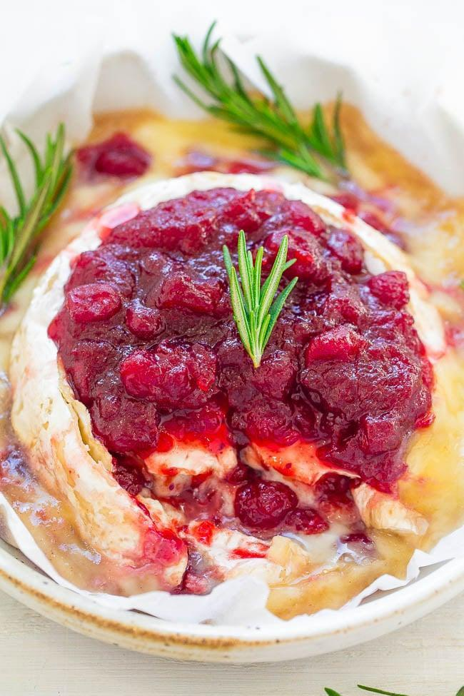 """<p>Give your feast a touch of elegance with baked Brie recipe. It pairs well with hearty main dishes and breads of all kinds.</p> <p><b>Get the recipe</b>: <a href=""""http://www.averiecooks.com/cranberry-baked-brie/#"""" class=""""link rapid-noclick-resp"""" rel=""""nofollow noopener"""" target=""""_blank"""" data-ylk=""""slk:cranberry baked Brie"""">cranberry baked Brie</a></p>"""