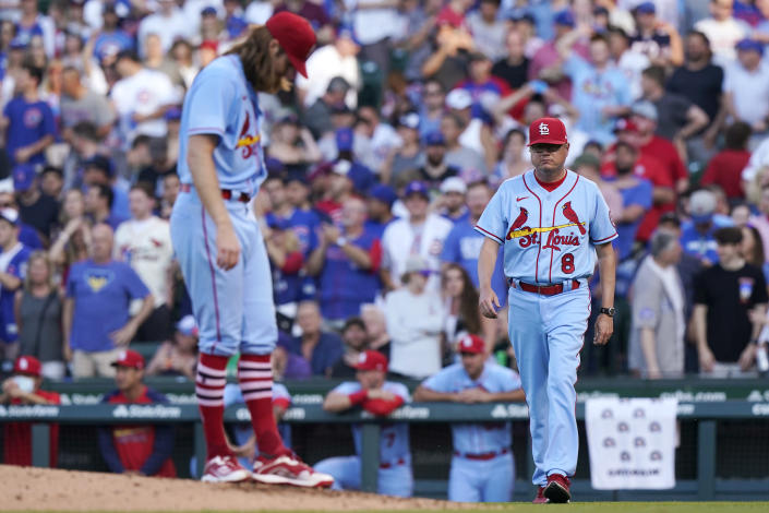 St. Louis Cardinals manager Mike Shildt, right, walks to the mound as starting pitcher John Gant looks down during the second inning of the team's baseball game against the Chicago Cubs in Chicago, Saturday, June 12, 2021. (AP Photo/Nam Y. Huh)