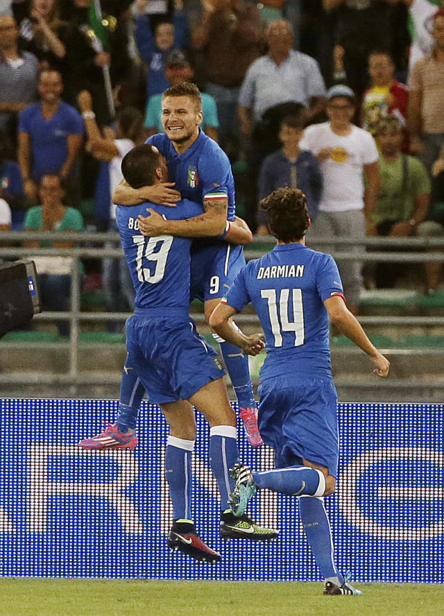 Italy's Ciro Immobile, top, celebrates after scoring during a friendly soccer match between Italy and The Netherlands in Bari, Italy, Thursday, Sept. 4, 2014. (AP Photo/Gregorio Borgia)