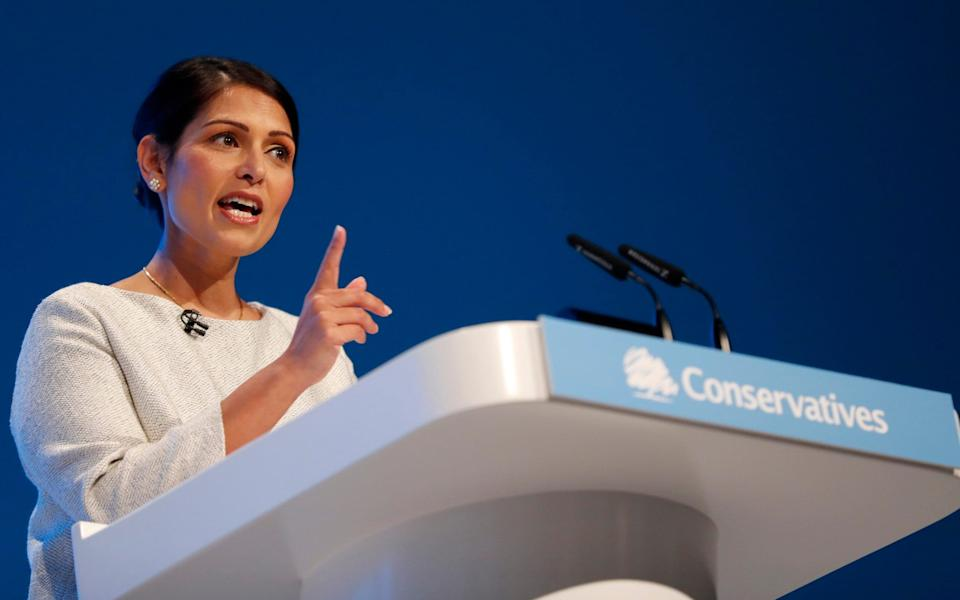 In this Tuesday, Oct. 1, 2019 file photo, Britain's Home Secretary Priti Patel addresses the delegates at the Conservative Party Conference in Manchester, England - Frank Augstein/AP