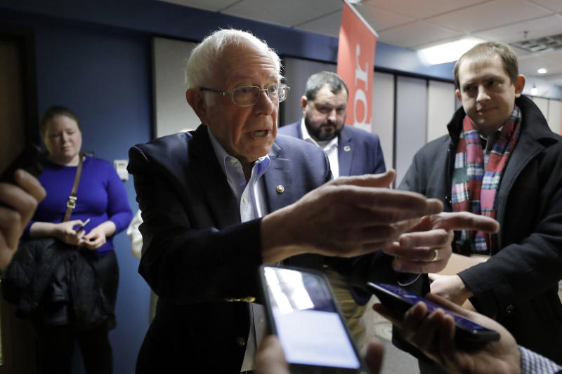 Democratic presidential candidate Sen. Bernie Sanders, I-Vt., speaks with reporters following a forum broadcast on radio in a New Hampshire Public Radio station, Sunday, Jan. 19, 2020, in Concord, N.H. (AP Photo/Steven Senne)