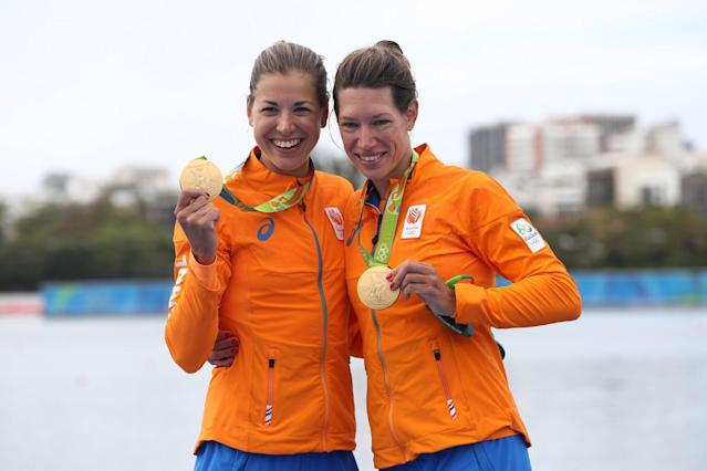 <p>Gold medalists Ilse Paulis and Maaike Head of the Netherlands pose for photographs on the podium at the medal ceremony for the Lightweight Women's Double Sculls on Day 7 of the Rio 2016 Olympic Games at Lagoa Stadium on August 12, 2016 in Rio de Janeiro, Brazil. (Getty) </p>