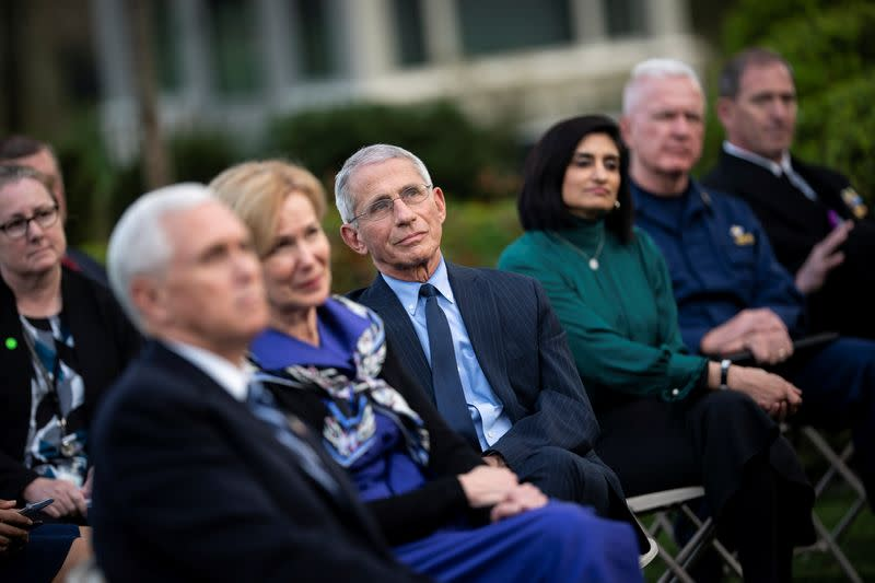 NIH National Institute of Allergy and Infectious Diseases Director Anthony Fauci listens as U.S. President Donald Trump speaks during a news conference in the Rose Garden of the White House