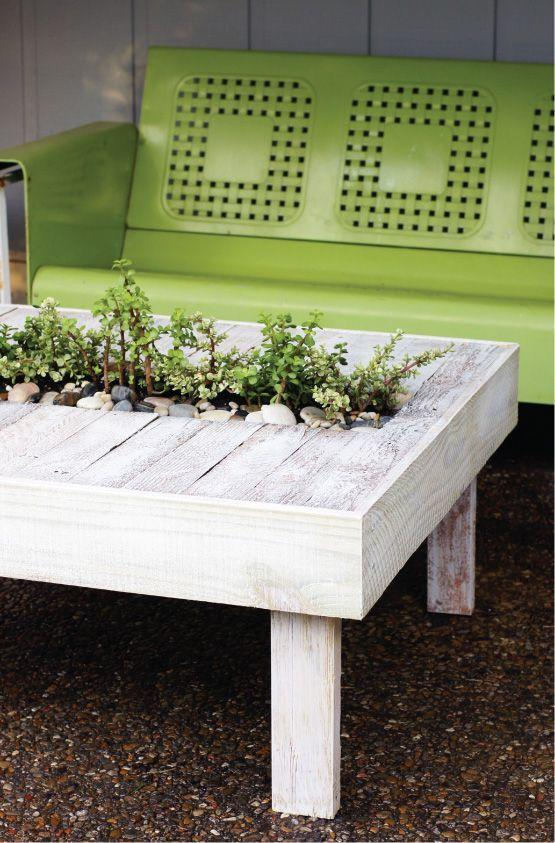 """<p>This clever table works hard for your yard: Not only is it a neat way to showcase plants, but it's also a nice spot to place your book as you sip lemonade.</p><p><a href=""""http://www.todaysnest.com/todays-nest-1/2011/07/palette-able-patio-cheap-chic-cocktail-table.html"""" rel=""""nofollow noopener"""" target=""""_blank"""" data-ylk=""""slk:Get the tutorial at Today's Nest »"""" class=""""link rapid-noclick-resp""""><em>Get the tutorial at Today's Nest »</em></a></p>"""