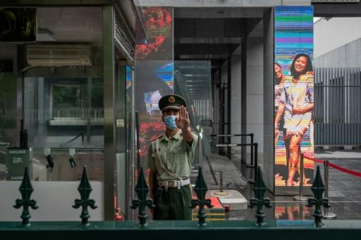 A Chinese paramilitary police officer stands at the entrance of the Australian embassy in Beijing in July 2020 amid high tensions