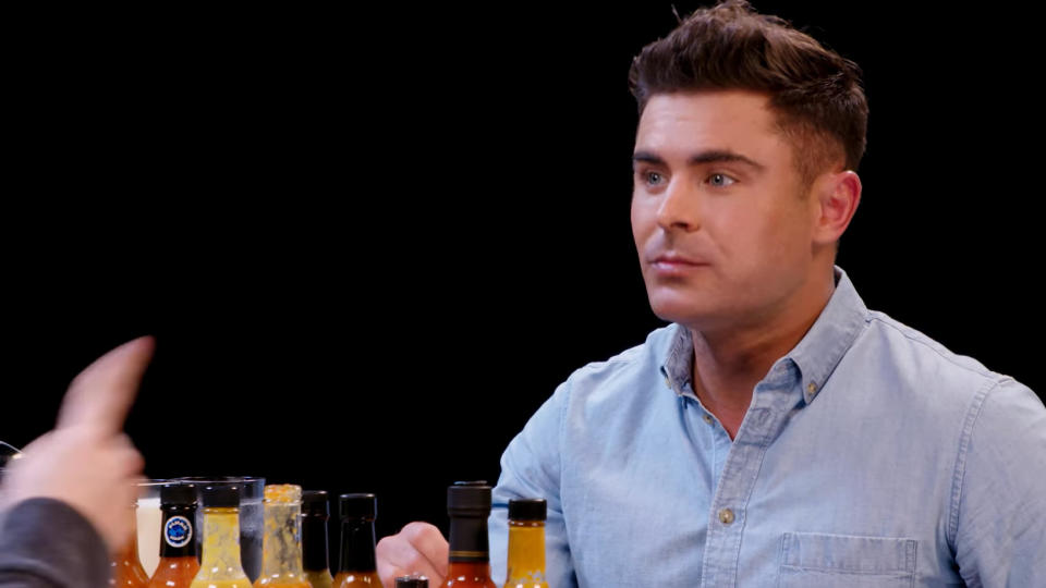 Zac Efron was interviewed while eating spicy wings on 'Hot Ones'. (Credit: YouTube/First We Feast)