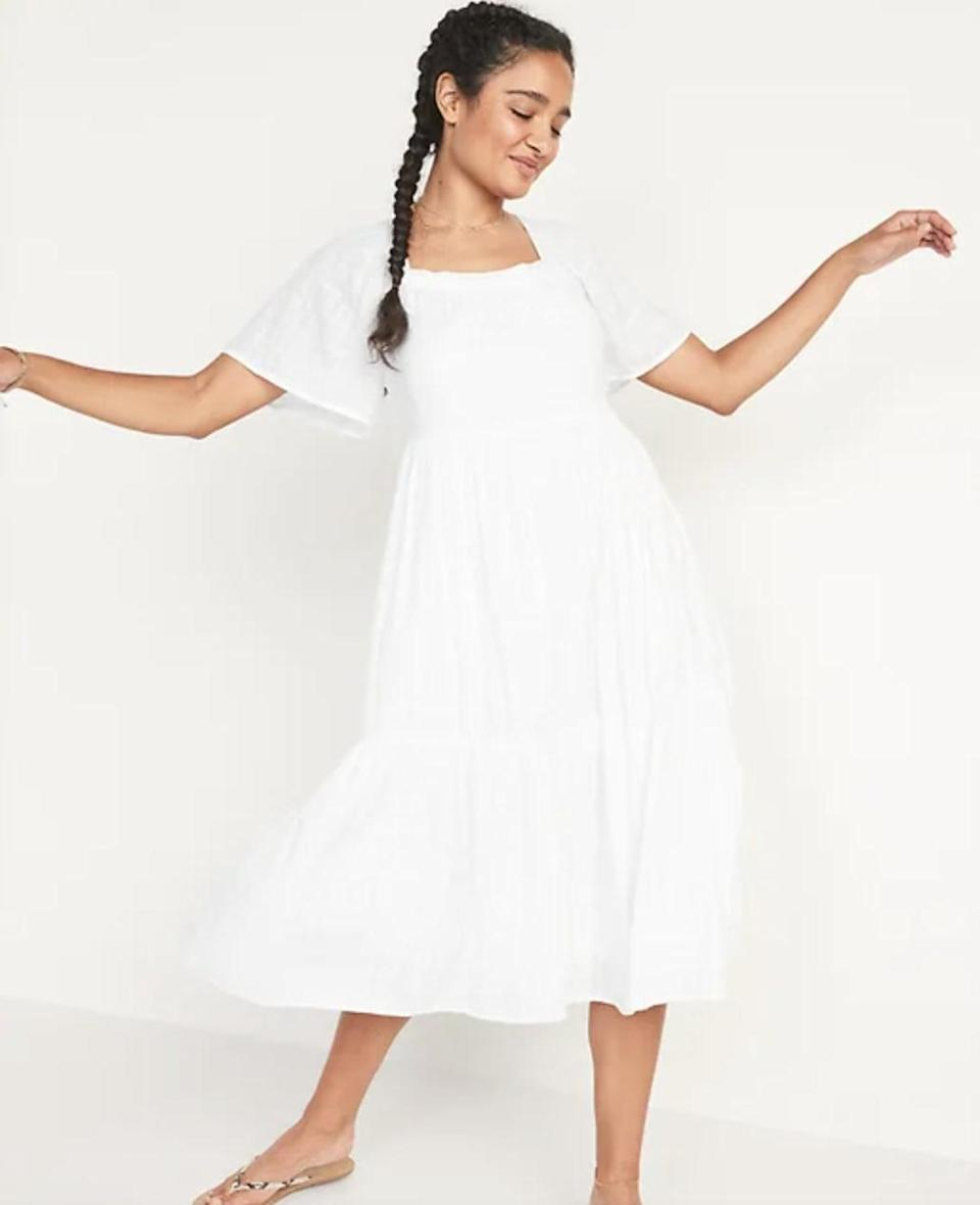 <p>If you're planning on packing up your white dresses for the season, this <span>Old Navy Dobby Bell-Sleeve Midi Swing Dress</span> ($45) might make you rethink this. It's seriously too comfortable and stylish to put away.</p>