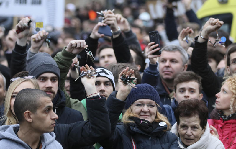 Demonstrators show their key chains during an anti-government rally in Bratislava, Slovakia, Friday, March 9, 2018. The country-wide protests demand a thorough investigation into the shooting deaths of Jan Kuciak and Martina Kusnirova, whose bodies were found in their home on Feb. 25, and changes in the government. (AP Photo/Ronald Zak)