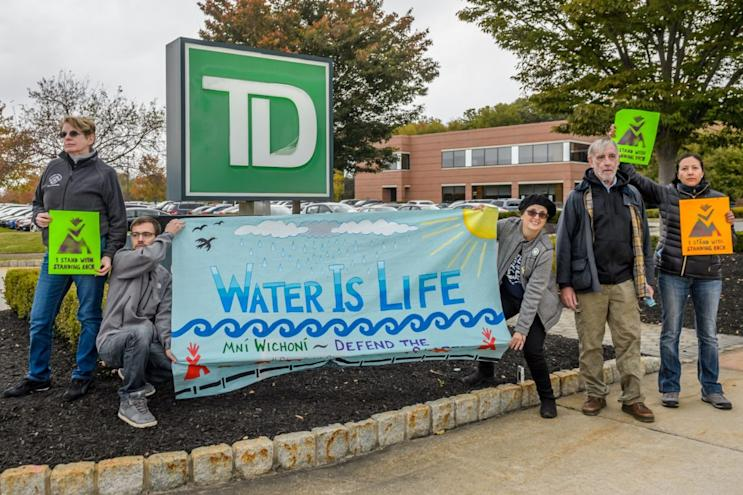 Protesters in New Jersey called on TD Bank to divest from the Dakota Access pipeline project. Photo from Getty Images.