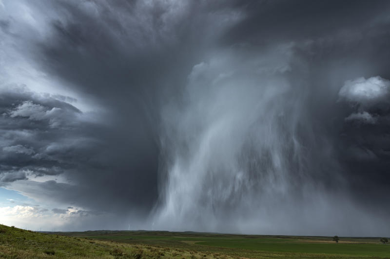 Extreme hail storm falling on the high plains of Nebraska. This extreme weather event caused damage to vehicles and property, Nebraska, USA.