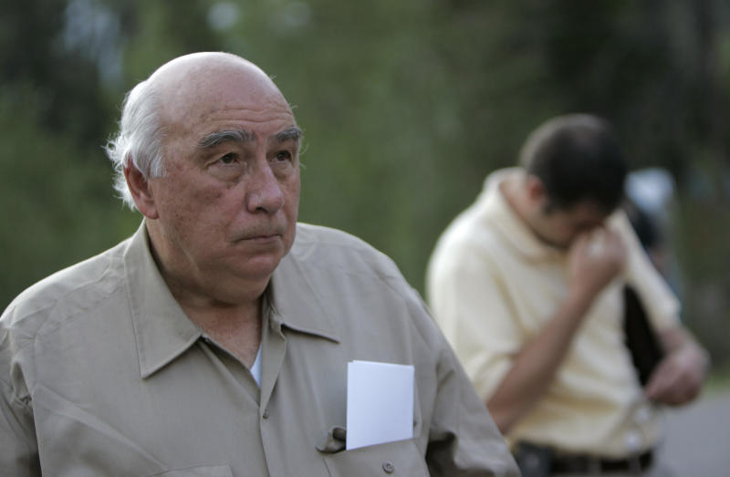 "FILE - In this Aug. 20, 2007 file photo, Robert ""Bob"" Murray, founder and chairman of Cleveland-based Murray Energy Corp., arrives at a news conference at the entrance to the Crandall Canyon Mine, in northwest of Huntington, Utah. In the early days of the Trump administration, Murray, the head of one of America's largest coal companies sent a four-page ""action plan"" to the White House calling for rollbacks of key environmental and mine safety regulations he claimed would help revive the struggling mining industry. A review by The Associated Press of that March 1, 2017, plan shows Murray, an early Trump campaign supporter, has gotten about half the items on his wish list. Still others, such as eliminating federal tax credits for wind turbines and solar panels, failed to win approval in Congress.  (AP Photo/Jae C. Hong, File)"