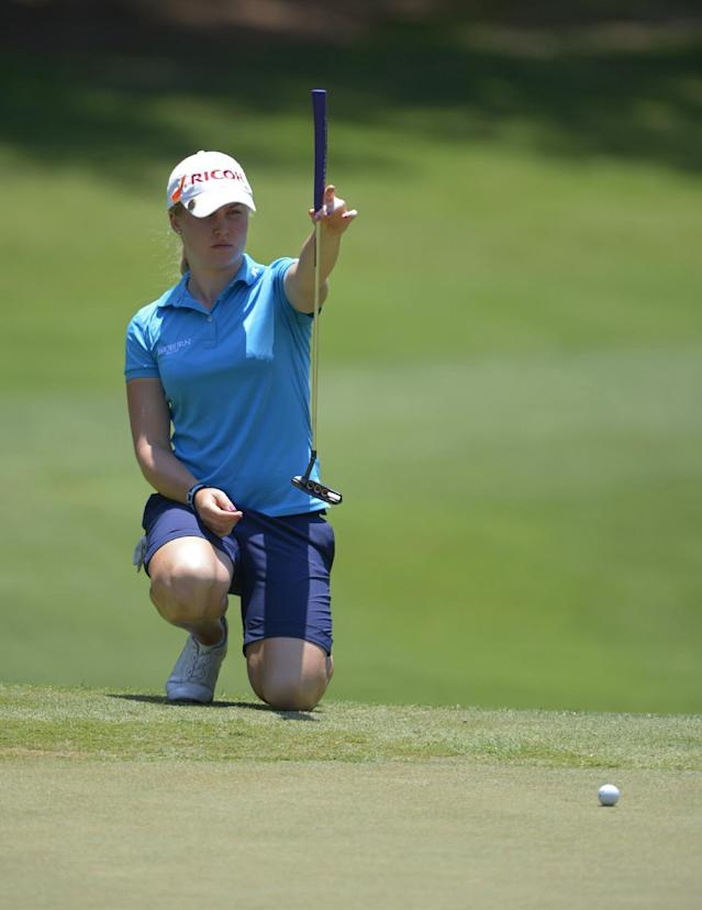 Charley Hull of England lines up a putt on the ninth green during the second round of the Airbus LPGA Classic golf tournament at Magnolia Grove on Friday, May 23, 2014, in Mobile, Ala. (AP Photo/G.M. Andrews)