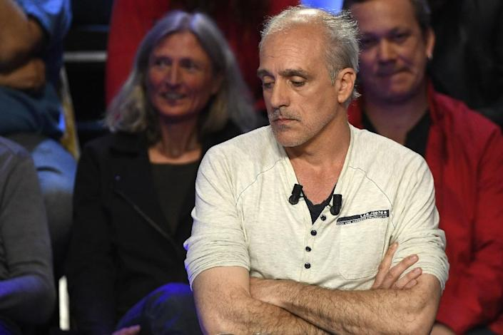 Philippe Poutou became a social media hit for his grumpy demeanour during the debate (AFP Photo/Lionel BONAVENTURE)