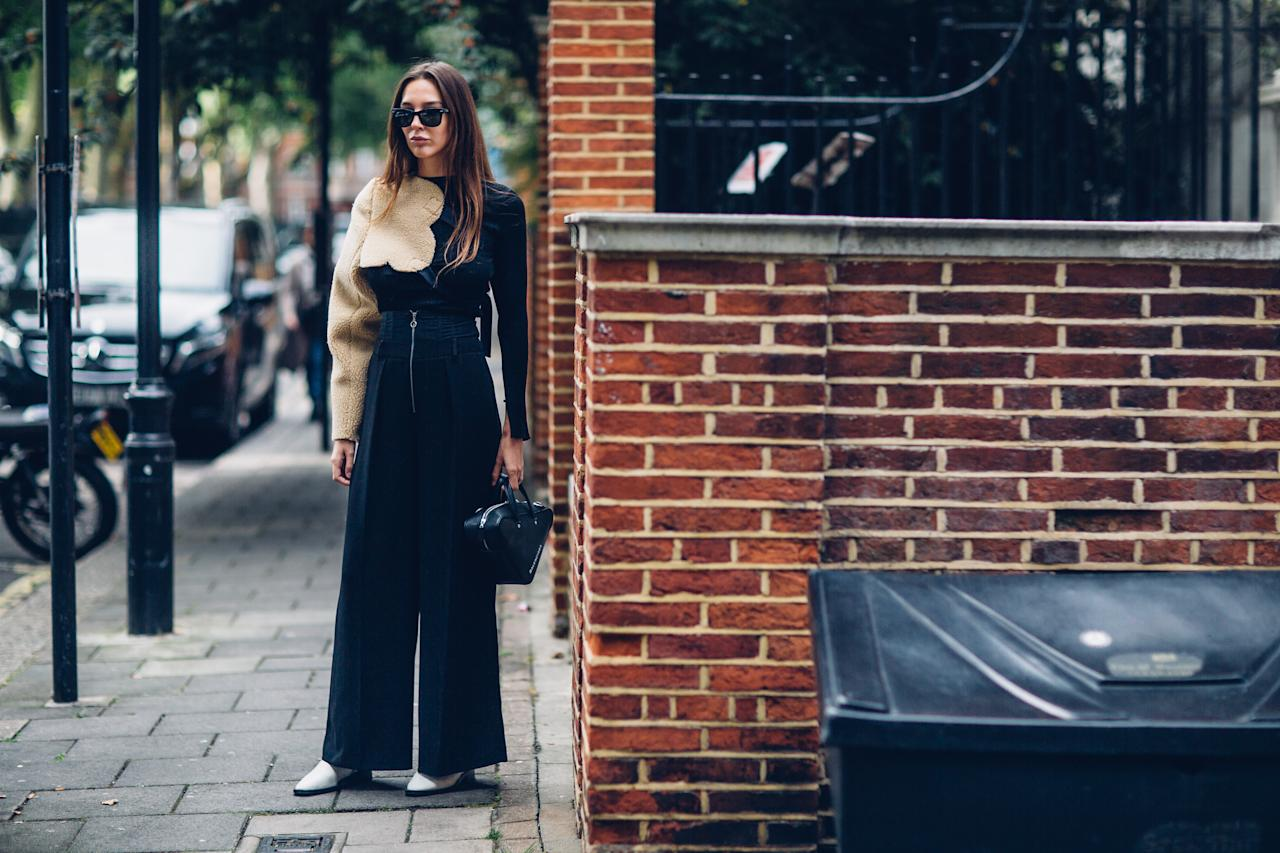 <p>Keeping warm in a jumper, this Fashion Week attendee showed us how to dress for a stylish Sunday. </p>