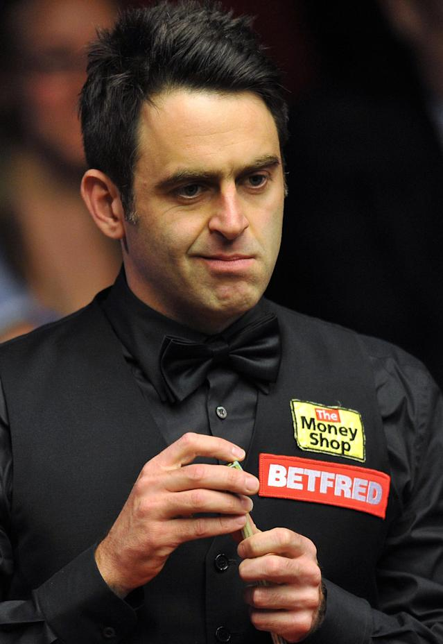 Ronnie O'Sullivan of England prepares to play a shot during a first round match of the World Championship Snooker tournament against Peter Ebdon of England at the Crucible Theatre in Sheffield, north-west England on April 24, 2012. AFP PHOTO / PAUL ELLIS (Photo credit should read PAUL ELLIS/AFP/Getty Images)