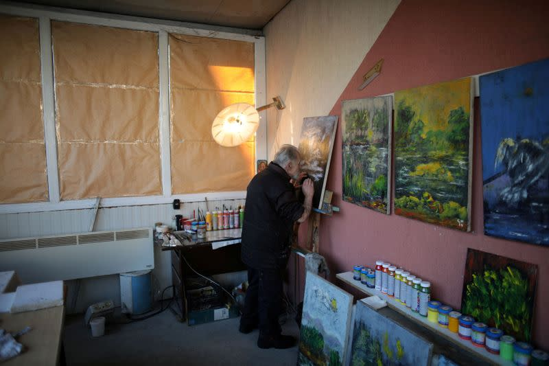 FILE PHOTO: Artist Karamfilov works on a painting at his studio in the city of Plovdiv
