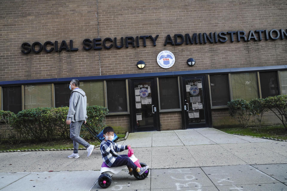 Photo by: John Nacion/STAR MAX/IPx 2020 10/20/20 A view of a child riding a bike in front of the New York State Social Security Administration in Flushing, Borough of Queens, New York City on October 20, 2020. Social Security Announces 1.3 Percent Benefit Increase for 2021.