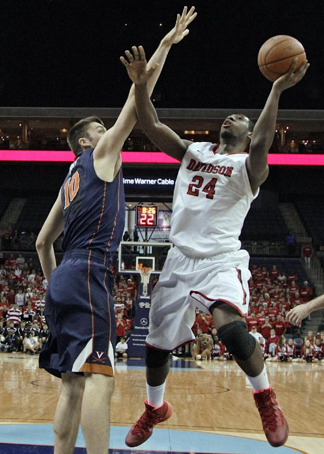 Davidson's De'Mon Brooks (24) shoots as Virginia's Mike Tobey (10) defends during the first half of an NCAA college basketball game in Charlotte, N.C., Saturday, Nov. 16, 2013. (AP Photo/Chuck Burton)