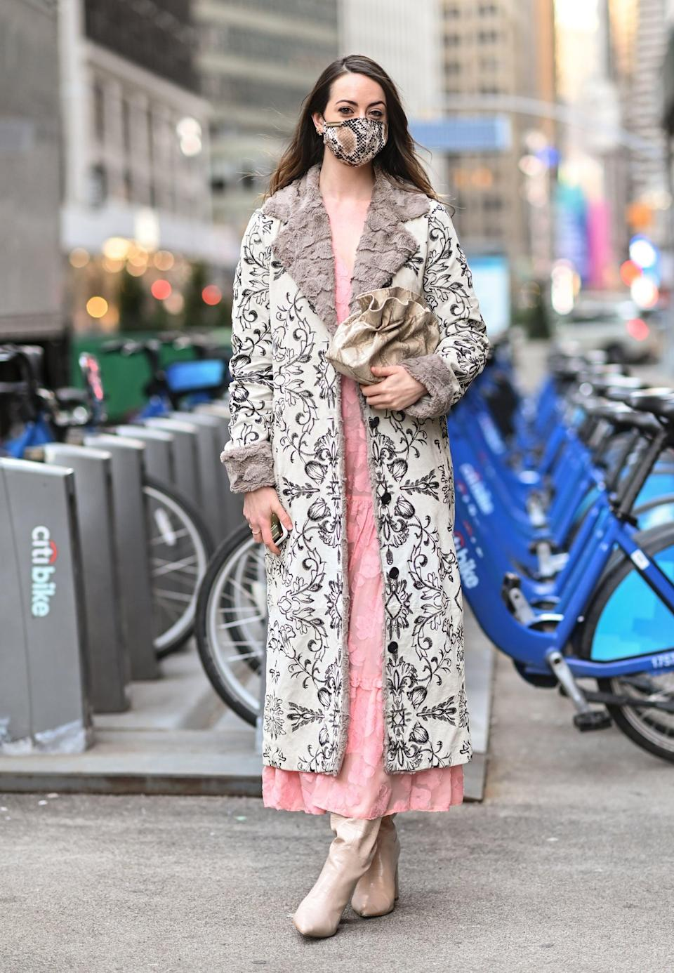 <p>The color scheme of this look works because of the soft palette. Sticking to similar tones allows you to mix in multiple prints and textures. Pro tip: long over long is an easy pairing for coats and dresses.</p>