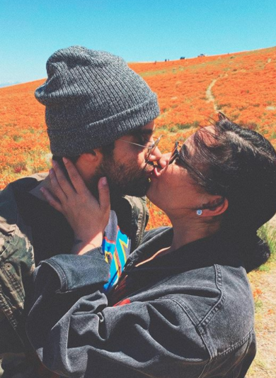 Demi Lovato and Max Ehrich kissing outside