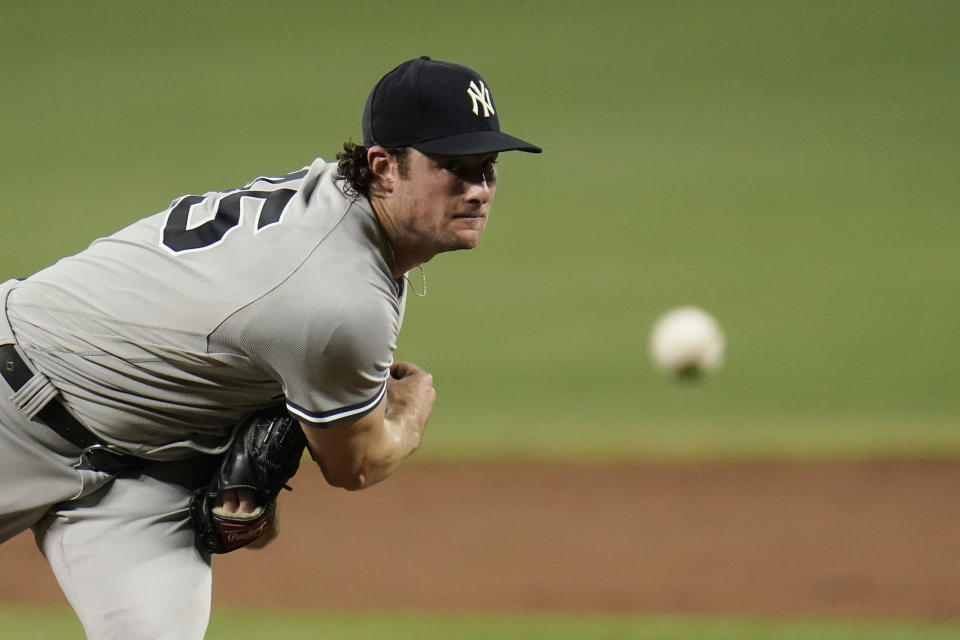 New York Yankees starting pitcher Gerrit Cole throws a pitch to the Baltimore Orioles during the second inning of a baseball game, Tuesday, Sept. 14, 2021, in Baltimore. (AP Photo/Julio Cortez)