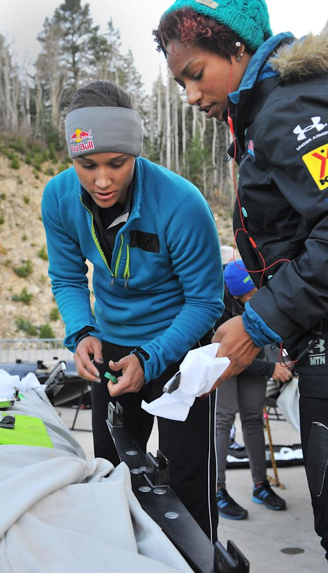 PARK CITY, UT - OCTOBER 25: USA bobsled teammates Lolo Jones and Jazmine Fenlator install the runners on their sled before the start of the bobsled selection runs at the Utah Olympic Park October 25, 2013 in Park City, Utah. (Photo by Gene Sweeney Jr/Getty Images)