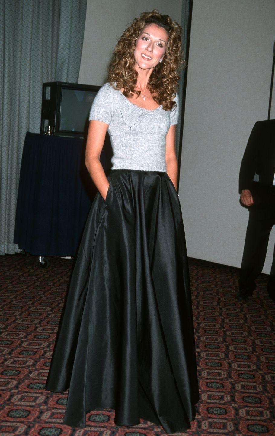 <p>The perfect mix of high-low fashion, Celine styled a t-shirt with a ball gown skirt at the 1999 People's Choice Awards. </p>