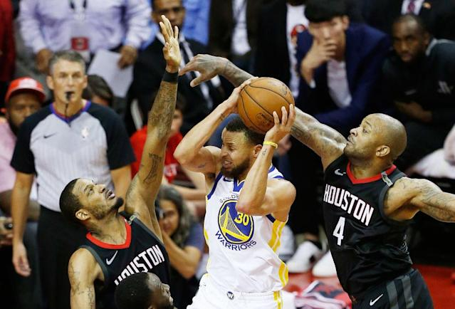 With Trevor Ariza and P.J. Tucker dogging opposing scorers on the wings, the Rockets rose up the defensive rankings and made it all the way to Game 7 of the Western Conference finals. (Getty)