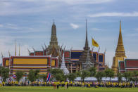 Supporters of the monarchy carrying flags of the monarchy and Thai national gather in front of the Grand Place in Bangkok, Thailand, Sunday, Nov. 1, 2020. Hundreds of royalists gathered close to the Grand Palace in which King Maha Vajiralongkorn is scheduled to visit for a Buddhist religious ceremony. (AP Photo/Wason Wanichakorn)