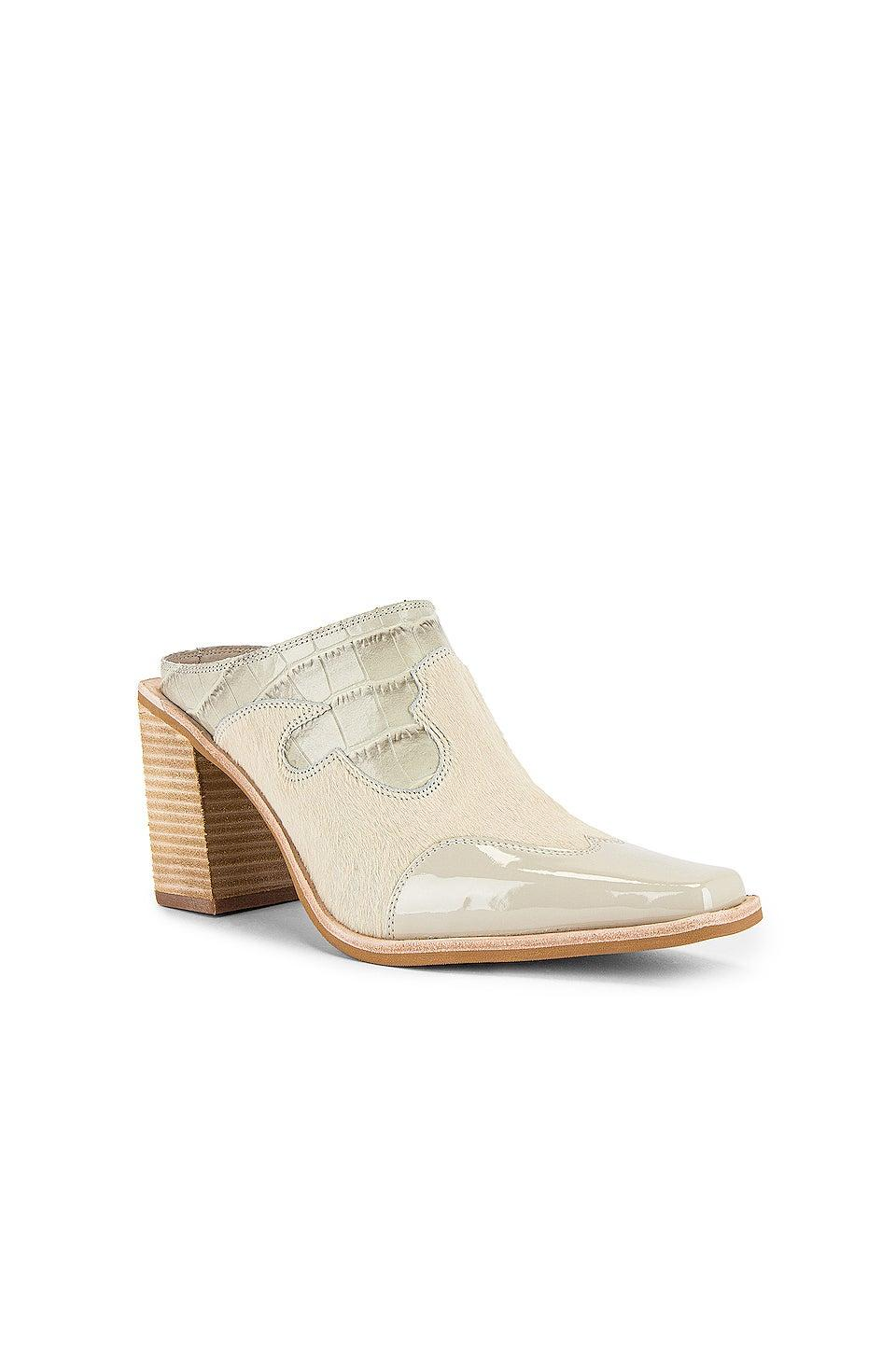 """<br><br><strong>Jeffrey Campbell</strong> Cowgirl Mule, $, available at <a href=""""https://go.skimresources.com/?id=30283X879131&url=https%3A%2F%2Fwww.revolve.com%2Fjeffrey-campbell-cowgirl-mule%2Fdp%2FJCAM-WZ1056%2F"""" rel=""""nofollow noopener"""" target=""""_blank"""" data-ylk=""""slk:Revolve"""" class=""""link rapid-noclick-resp"""">Revolve</a>"""