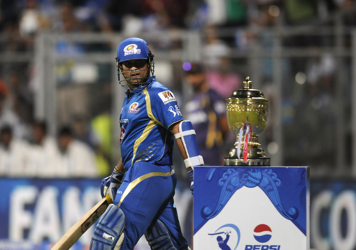 Sachin Tendulkar of Mumbai Indians has a closer look at the IPL trophy as he walks to bat during match 53 of the Pepsi Indian Premier League ( IPL) 2013  between The Mumbai Indians and the Kolkata Knight Riders held at the Wankhede Stadium in Mumbai on the 7th May 2013 ..Photo by Pal Pillai-IPL-SPORTZPICS  ..Use of this image is subject to the terms and conditions as outlined by the BCCI. These terms can be found by following this link:..https://ec.yimg.com/ec?url=http%3a%2f%2fwww.sportzpics.co.za%2fimage%2fI0000SoRagM2cIEc&t=1498381641&sig=fmcoORznhipAD2M0TA7J1g--~C