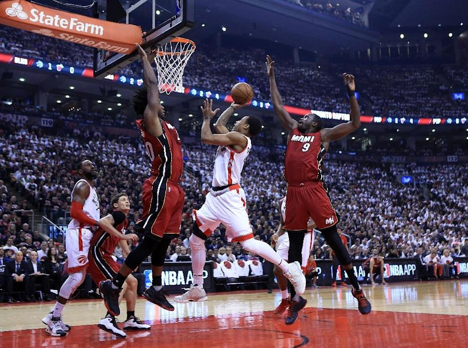 DeMar DeRozan (C) finished with 28 points and eight rebounds as Toronto finally pulled away in the second half (AFP Photo/Vaughn Ridley)