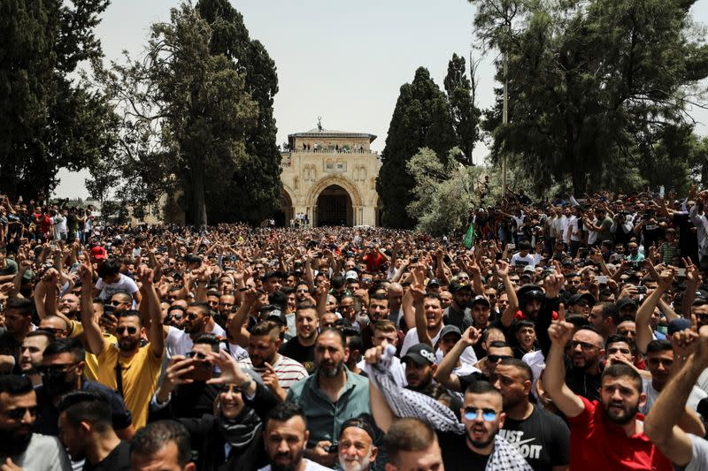 Palestinians shout slogans at the compound that houses Al-Aqsa Mosque in Jerusalem's Old City