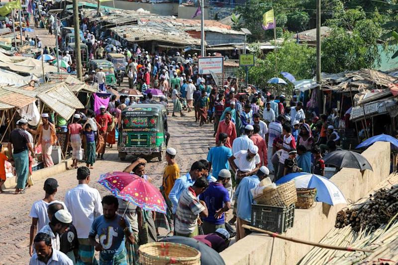 Rohingya refugees gather at a market