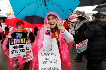 Los Angels public school teachers continue to deal with the rainy weather as their strike enters its third day in Gardena, California, U.S., January 16, 2019. REUTERS/Mike Blake