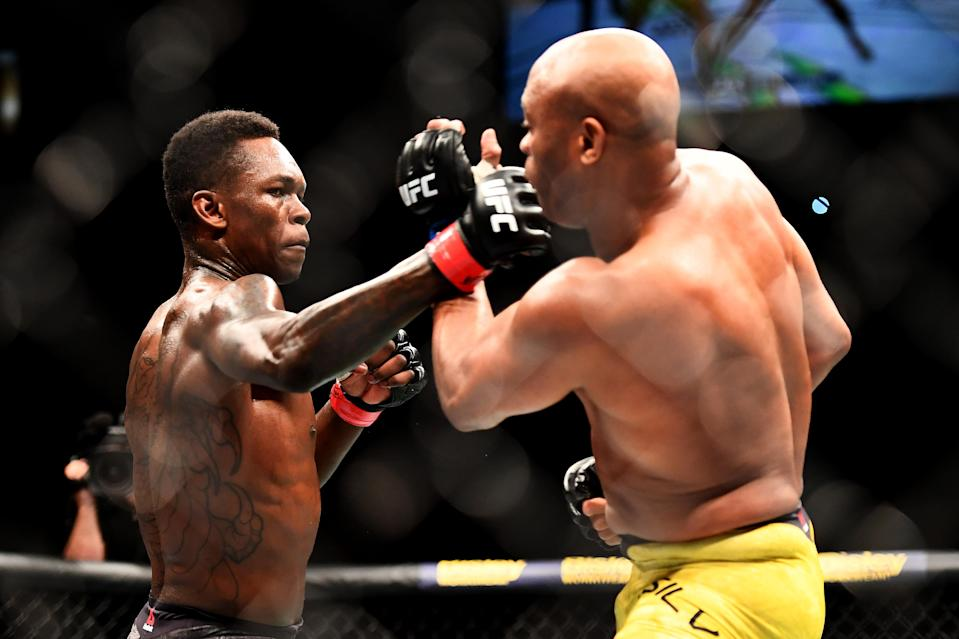 Israel Adesanya punches Anderson Silva during their middleweight bout during UFC 234 at Rod Laver Arena on Feb. 10, 2019 in Melbourne, Australia. (Getty Images)