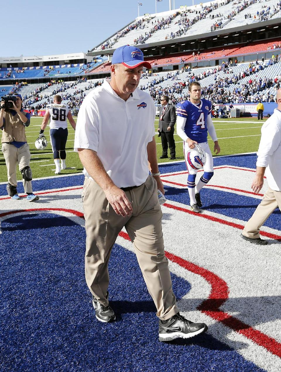 FILE - In this Sept. 21, 2014, file photo, Buffalo Bills head coach Doug Marrone walks off the field after an NFL football game against the San Diego Chargers in Orchard Park, N.Y. Marrone has stepped down as coach of the Bills. Bills owner Terry Pegula said Wednesday, Dec. 31 that Marrone exercised the opt-out clause in his contract. (AP Photo/Bill Wippert, File)