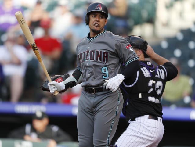 Arizona Diamondbacks' Jon Jay reacts after striking out to Colorado Rockies starting pitcher German Marquez during the first inning of a baseball game Friday, June 8, 2018, in Denver. (AP Photo/David Zalubowski)
