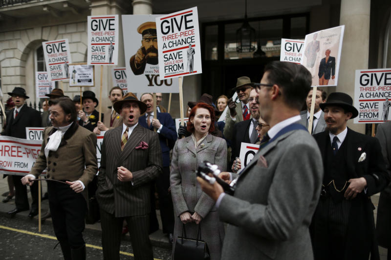 Chaps and chapettes take part in a protest outside the Abercrombie & Fitch flagship store on Burlington Gardens against the proposed opening of a children's branch of the U.S. clothing retailer around the corner on Savile Row, the traditional men's bespoke tailoring street in the Mayfair district of London, Monday, April 23 , 2012. The protest on Monday was organised by The Chap magazine, a publication for English gentlemen whose manifesto includes always wearing tweed and cultivating interesting moustaches. (AP Photo/Matt Dunham)