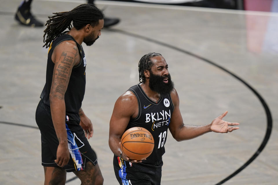 Brooklyn Nets' James Harden (13) and DeAndre Jordan react to a call during the first half of the team's NBA basketball game against the Toronto Raptors on Friday, Feb. 5, 2021, in New York. (AP Photo/Frank Franklin II)