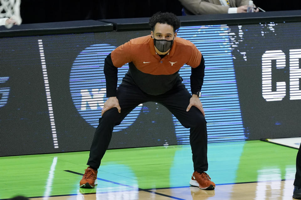 Texas head coach Shaka Smart watches the action during the first half of a college basketball game against Abilene Christian in the first round of the NCAA tournament at Lucas Oil Stadium in Indianapolis Saturday, March 20, 2021. (AP Photo/Mark Humphrey)