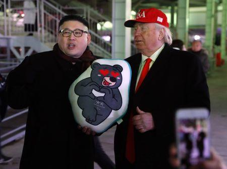 Pyeongchang 2018 Winter Olympics - Closing ceremony - Pyeongchang Olympic Stadium - Pyeongchang, South Korea - February 25, 2018 - Two men dressed as look-a-likes of U.S. President Donald Trump and North Korean leader Kim Jong Un pose. REUTERS/Leonhard Foeger