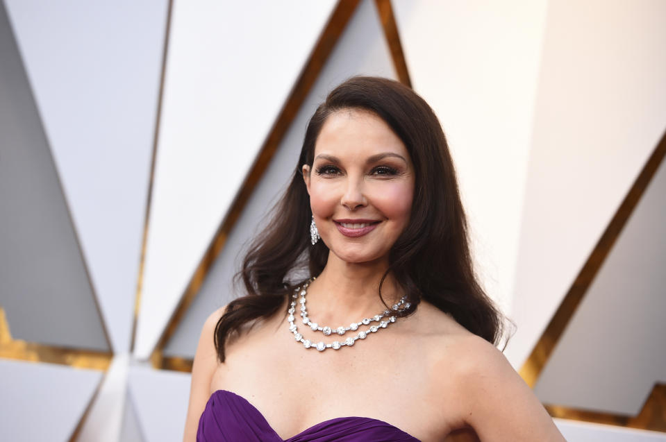 FILE - In this March 4, 2018, file photo, Ashley Judd arrives at the Oscars at the Dolby Theatre in Los Angeles. Harvey Weinstein's lawyers say Judd's allegations that he tried to hurt her career after she rejected him sexually are baseless, and they have asked a judge to dismiss her lawsuit against him. The court documents filed Wednesday, July 18, discuss Judd's comment that she would only let Weinstein touch her after she won an Academy Award in one of his films. (Photo by Jordan Strauss/Invision/AP, File)