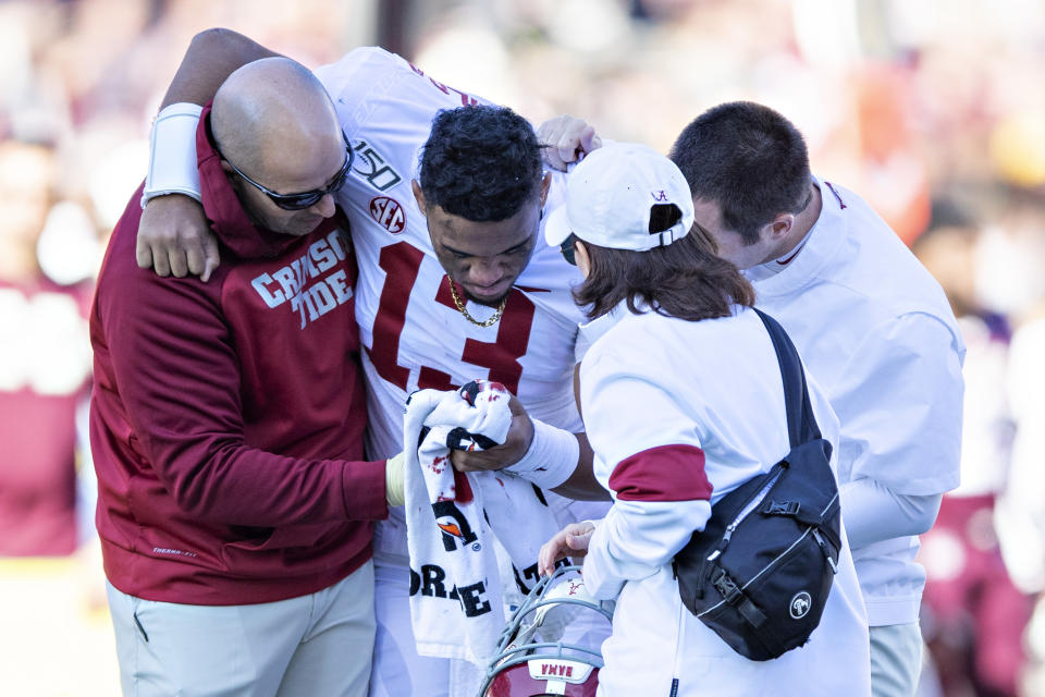 Tua Tagovailoa's hip injury leaves his 2020 NFL draft stock in serious doubt. (Photo by Wesley Hitt/Getty Images)