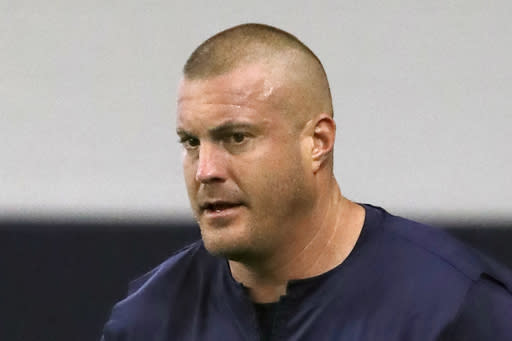 FILE - In this June 11, 2019, file photo, then-Dallas Cowboys offensive line coach Marc Colombo participates in drills at the team's NFL football training facility in Frisco, Texas. A person with knowledge of the situation has told The Associated Press that the New York Giants have fired offensive line coach Marc Colombo. The person asked not to be identified because the team has not confirmed the move. When the Giants hired former Cowboys coach Jason Garrett to be the offensive coordinator, Colombo followed him here. (AP Photo/Tony Gutierrez, File)